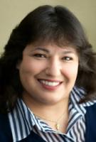 Gloria Herrera, Broker